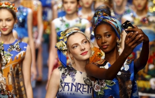 Models take selfie with mobile phone as they present creations from the Dolce & Gabbana Spring/Summer 2016 collection during Milan Fashion Week in Italy, September 27, 2015.  REUTERS/Stefano Rellandini